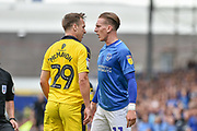 Oxford United Defender, Tony McMahon (29) and Portsmouth Midfielder, Ronan Curtis (11) face up during the EFL Sky Bet League 1 match between Portsmouth and Oxford United at Fratton Park, Portsmouth, England on 18 August 2018.