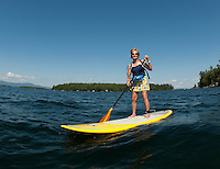 Bunny Brauns enjoys the afternoon on a stand up paddle board making her way through Lockes Island and Varney Point on Lake Winnipesaukee Thursday.   (Karen Bobotas/for the Laconia Daily Sun)