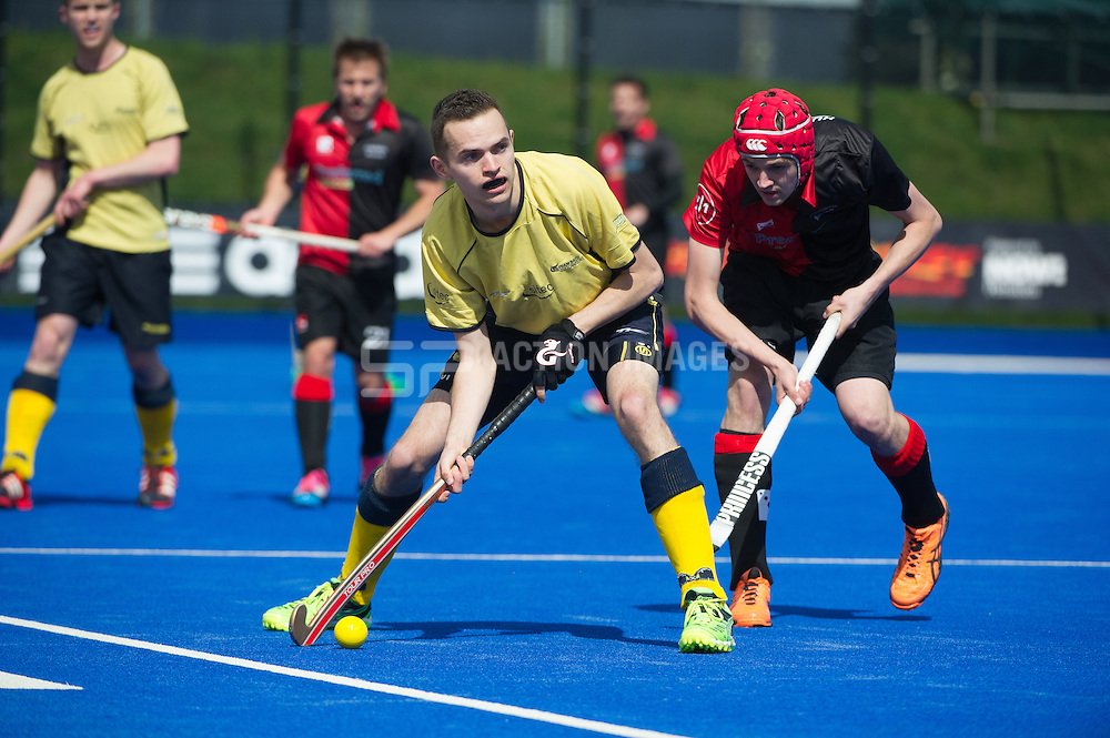 Team Bath Buccaneers' Pav Lochab is watched by by Alex Humphreys of Bowdon. Bowdon v Team Bath Buccaneers - Now: Pensions Finals Weekend, Lee Valley Hockey & Tennis Centre, London, UK on 11 April 2015. Photo: Simon Parker