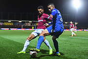 Wimbledon defender Rod McDonald (26) and West Ham United defender Ryan Fredericks  (24) battle for the ball during the The FA Cup fourth round match between AFC Wimbledon and West Ham United at the Cherry Red Records Stadium, Kingston, England on 26 January 2019.