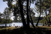 People take sunbath and swim at Manera and Ferraio little beach at a bight of Ticino river, Somma Lombardo...Bagnanti alla spiaggetta Manera e Ferrario nell'ansa del fiume Ticino, Somma Lombardo.