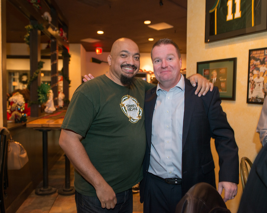 December 5, 2015 - Fairfax, VA - &quot;Doc Nix,&quot; aka Dr. Michael Nickens, the Director of the Athletic Bands for George Mason University and Dave Paulsen, GMU Basketball coach at Brion's Grille.<br /> <br /> Photo by Susana Raab