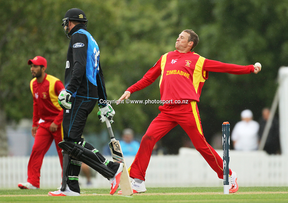 Sean Williams of Zimbabwe bowling during the ICC Cricket World Cup warm up game between the Black Caps v Zimbabwe at Bert Sutcjliffe Oval, Lincoln, Christchurch. 9 February 2015 Photo: Joseph Johnson / www.photosport.co.nz