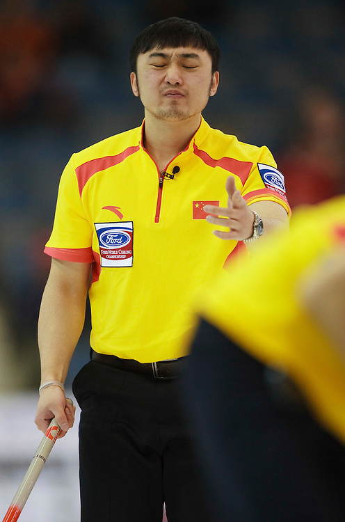 China's Skip Yansong Ji reacts to his shot during the 10th end of their 5-4 loss to Canada at the World Curling Championships at the Brandt Centre in Regina, Saskatchewan, April 7, 2011.<br /> AFP PHOTO/Geoff Robins