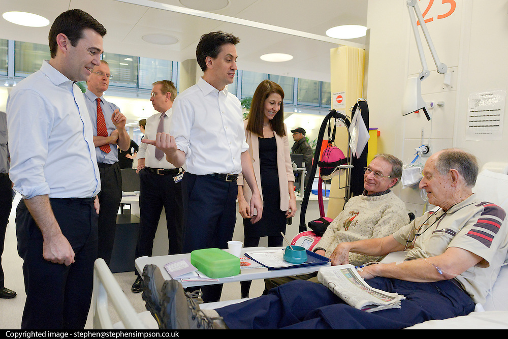 © Licensed to London News Pictures. 24/01/2013. London, UK L-R Andy Burnham, Ed Miliband, Liz Kendall, (sitting) Bob Harris, (On Bed) Ray Barnes. Leader of the Labour Party, Ed Miliband, Shadow Health Secretary Andy Burnham and Shadow Health Minister Liz Kendall visit the Macmillan Cancer Centre at University College Hospital in Central London today, 24 January 2013. Today the Labour Party launched its Whole Person Care policy review. Photo credit : Stephen Simpson/LNP