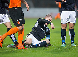 Dundee's James McPake tackles Dundee United&rsquo;s John Rankin and gets stretchered off. <br /> Half time : Dundee 1 v 1  Dundee United, SPFL Ladbrokes Premiership game played 2/1/2016 at Dens Park.