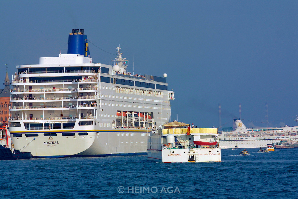 The Casanova is dwarfed by ocean-going cruise ships while following the Canale della Giudecca.
