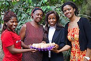 Peace (left), Ifeoma (right) and Njideka Harry (far right), from Youth for Technology pictured here with Ijeoma.<br /> <br /> Ijeoma Ewurum used to keep chickens as a hobby but when she retired from her teaching career she set it up as a larger business. <br /> <br /> She attended a business training workshop with Youth for Technology and signed up to receive Business SMS support.<br /> <br /> The main examples of success and impact from the SMS are around innovation and improving product quality; as a result she invested in new feed and vitamins and now has bigger and better eggs and heavier healthier birds. <br /> <br /> What she valued most from the training was learning about capital – she has not heard that word before but now understands the need to reinvest in your business. From the face to face she also valued meeting other women who offered advice.