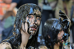 "© Licensed to London News Pictures. 13/09/2019. London, UK. A campaigner from People for the Ethical Treatment of Animals (PETA) protests against the hazardous waste associated with the leather industry are covered in black ""toxic slime"" on the opening day of London Fashion Week. Photo credit: Dinendra Haria/LNP"