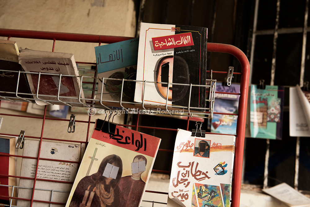 Iraq, Mosul: Library in a newly liberated area in west Mosul. <br /> The faces have been hidden according with rules imposed to the population by ISIS members. Alessio Romenzi