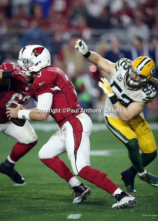 Arizona Cardinals quarterback Carson Palmer (3) is chased by Green Bay Packers inside linebacker Clay Matthews (52) as he scrambles and throws an overtime pass to Arizona Cardinals wide receiver Larry Fitzgerald (11) for a 75 yard gain and a first down and goal to go at the Packers 5 yard line, setting up the winning touchdown, during the NFL NFC Divisional round playoff football game against the Green Bay Packers on Saturday, Jan. 16, 2016 in Glendale, Ariz. The Cardinals won the game in overtime 26-20. (©Paul Anthony Spinelli)