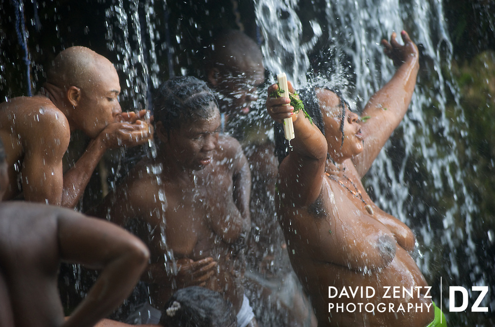 Worshippers cleanse themselves beneath the falls of Saut D'eau in central Haiti, the site of an annual voodoo festival held in July.