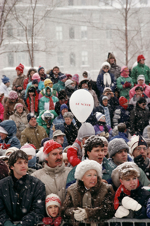 Crowd watches snow bathers at the yearly Winter Carnival. Quebec, Canada.