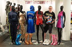 © Licensed to London News Pictures. 26/07/2018. London, UK. Organiser and curator Alan Smith-Allison poses with various clothing and shoes worn by Mel B, Melanie C, Geri Halliwell, Victoria Beckham, Emma Bunton at the Spice Girls exhibition. The interactive exhibition features hundreds of iconic stage, music video and film costumes worn by the popular 90s girl band at Business Design Centre/Photo credit: Ray Tang/LNP