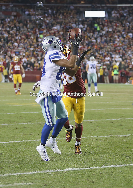 Dallas Cowboys wide receiver Terrance Williams (83) catches a 38 yard second quarter pass for a first down at the Washington Redskins 21 yard line while covered by Washington Redskins free safety Dashon Goldson (38) during the 2015 week 13 regular season NFL football game against the Washington Redskins on Monday, Dec. 7, 2015 in Landover, Md. The Cowboys won the game 19-16. (©Paul Anthony Spinelli)
