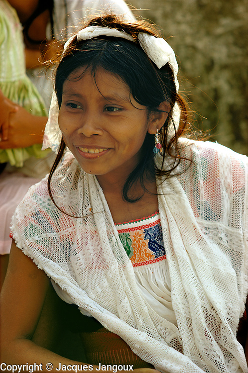 Smiling young Indian woman at market in Cuetzalan, Puebla State, Mexico.