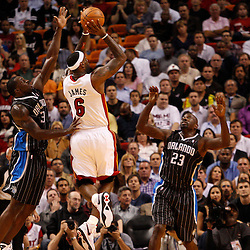 March 3, 2011; Miami, FL, USA; Miami Heat small forward LeBron James (6) shoots over Orlando Magic power forward Brandon Bass (30) during the first quarter at the American Airlines Arena.    Mandatory Credit: Derick E. Hingle