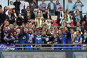 AFC Wimbledon defender Barry Fuller (2) lifting the trophy after winning the Sky Bet League 2 play off final match between AFC Wimbledon and Plymouth Argyle at Wembley Stadium, London, England on 30 May 2016.