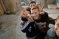 ©WEST BANK 2007. Kids playing with toy gun, Yamoun..Picture featured in book KIDS photos by Markus Marcetic, published 2007.