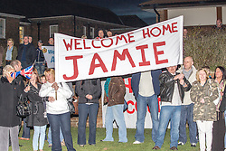 © Licensed to London News Pictures . 25/04/2013. Catterick Barracks , North Yorkshire , UK . Families wait outside for the returning soldiers to parade back . Soldiers from the 1st Battalion , the Duke of Lancaster's Regiment (1 Lancs) arrive at Catterick Barracks to be greeted by their families this evening (Thursday 25th April), following a six month tour in Lashkar Gah , Helmand Province , Afghanistan . With the UK combat mission due to complete by the end of 2014 , this is likely to be the last deployment by 1 Lancs in Afghanistan , the British Army reports . Photo credit : Joel Goodman/LNP