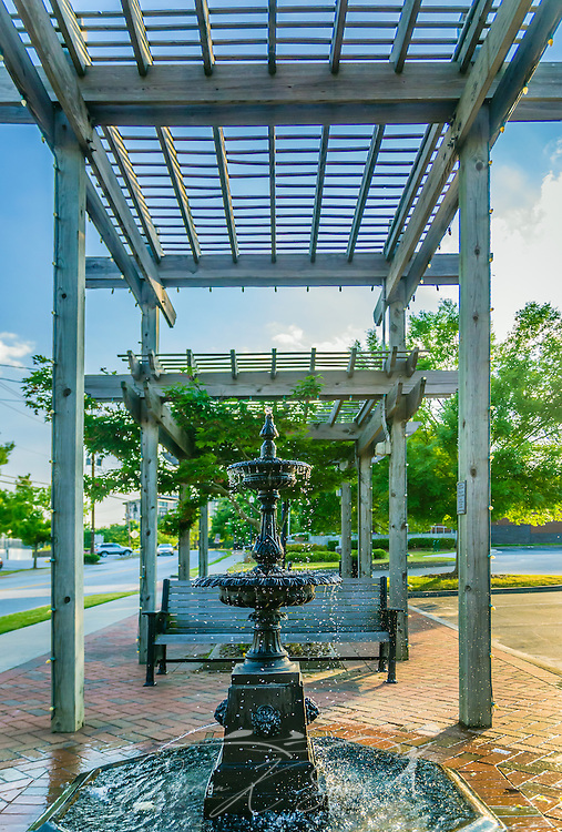 The sun sets on a fountain and pergola in downtown Chamblee, Georgia, May 20, 2014. (Photo by Carmen K. Sisson/Cloudybright)