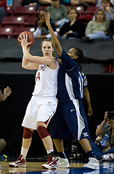 March 29, 2010; Sacramento, CA, USA; Stanford Cardinal forward Kayla Pedersen (14) is guarded by Xavier Musketeers forward April Phillips (42) during the second half in the finals of the Sacramental regional in the 2010 NCAA womens basketball tournament at ARCO Arena. Stanford defeated Xavier 55-53.