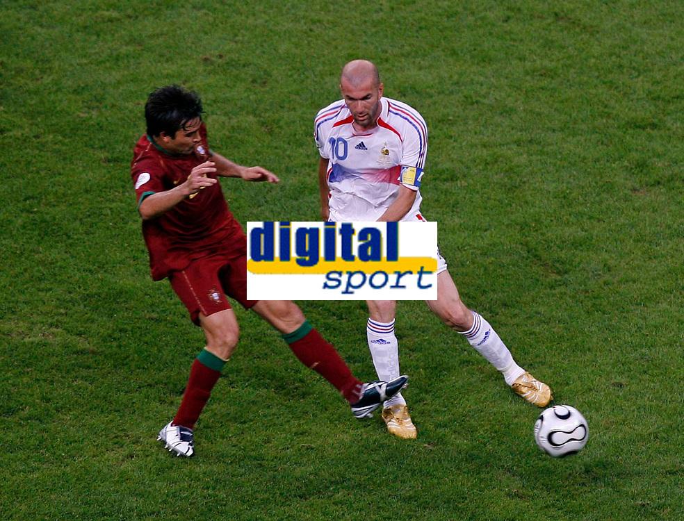 Photo: Glyn Thomas.<br />Portugal v France. Semi Final, FIFA World Cup 2006. 05/07/2006.<br /> France's Zinedine Zidane (R) and Portugal's Deco.