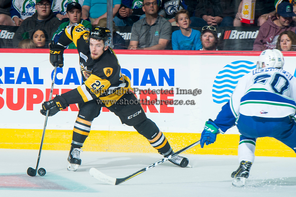 REGINA, SK - MAY 21:Marian Studenic #28 of Hamilton Bulldogs skates with the puck as Aleksi Heponiemi #20 of Swift Current Broncos checks at the Brandt Centre on May 21, 2018 in Regina, Canada. (Photo by Marissa Baecker/CHL Images)