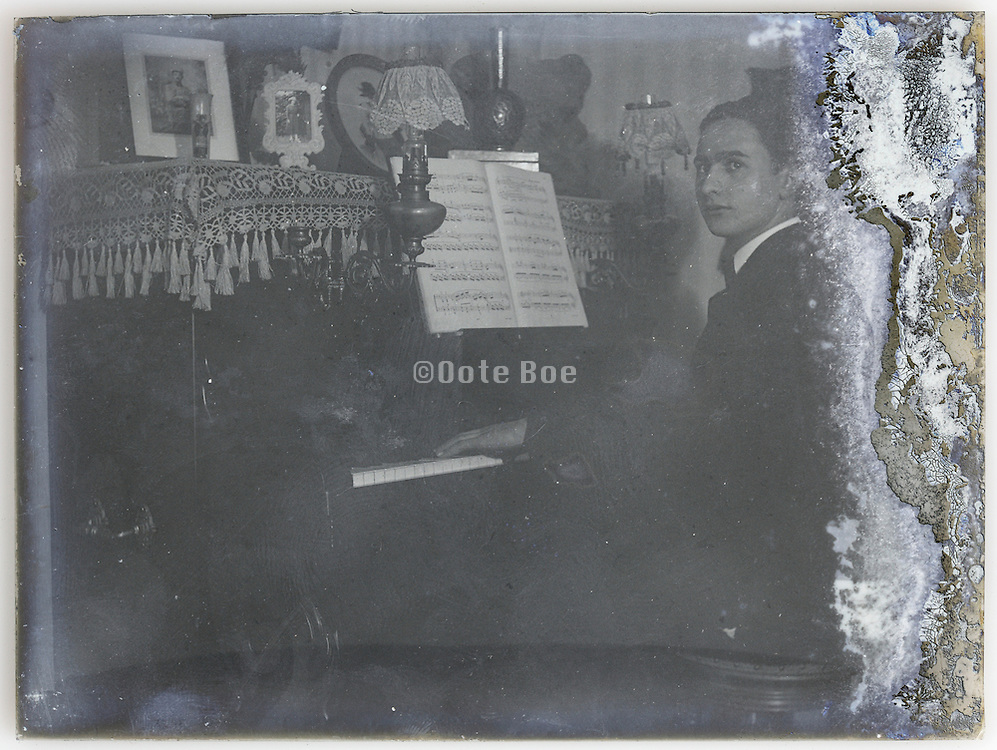 male person playing the piano portrait on fading glass plate