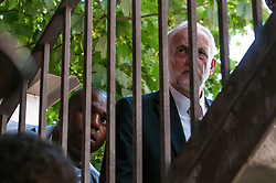 © Licensed to London News Pictures. 19/06/2017. Jeremy Corbyn & David Lammy walk around the back of Finsbury Park  mosque avoiding Theresa May. The Labour Party leader visited the mosque after a van was used to run down members of the muslim community as they finished taraweeh, Ramadan evening prayers. Photo credit: Guilhem Baker/LNP