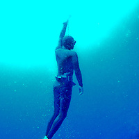 "A free diver ascends inside the Blue Hole off the coast of Dahab, Egypt. The Blue Hole is notorious for the number of diving fatalities which have occurred there, earning it the sobriquet ""World's Most Dangerous Dive Site"" and the nickname ""Diver's Cemetery"". The site is signposted by a sign that says ""Blue hole: Easy entry"". Accidents are frequently caused when divers attempt to find the tunnel through the reef (known as ""The Arch"") connecting the Blue Hole and open water at about 52 m depth. According to dive experts roughly 10 people die each year. April 2012."