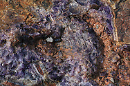 Rich vein of amethyst glimmers at Amethyst Mine Panorama, largest deposit in Canada; Dorion, Ontario.
