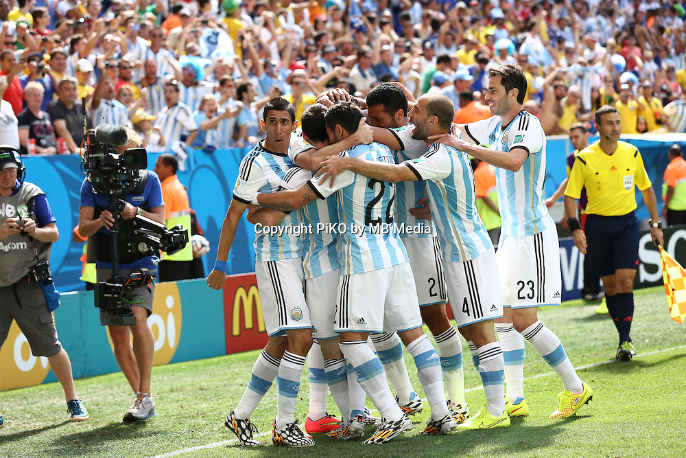 Fifa Soccer World Cup - Brazil 2014 - <br /> ARGENTINA (ARG) Vs. BELGIUM (BEL) - Quarter-finals - Estadio Nacional Brasilia -- Brazil (BRA) - 05 July 2014 <br /> Here Argentine players Angel Di Maria (L), Lionel Messi (C), Gonzalo Higuain (C) , Pablo Zabaleta (R), Ezequiel Lavezzi (C), Lucas Biglia (R) and Jose Maria Basanta (R) celebrating Higuain's goal. Scoring the match 1-0.<br /> &copy; PikoPress