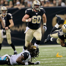 Dec 27, 2015; New Orleans, LA, USA; New Orleans Saints running back Travaris Cadet (38) is upended by Jacksonville Jaguars strong safety Johnathan Cyprien (37) during the second quarter of a game at the Mercedes-Benz Superdome. Mandatory Credit: Derick E. Hingle-USA TODAY Sports