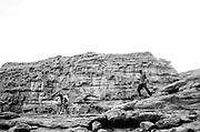 People on cliffs at Middle East Tek, Wadi Rum, Jordan, 2008