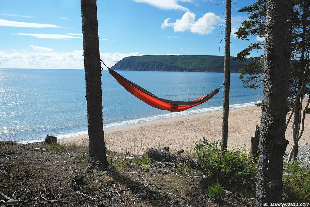 A hammock overlooking Ingonish Beach, Cape Breton Highlands National Park, Nova Scotia, Canada.