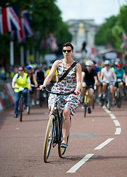 © London News Pictures. 03/08/2013. London, UK. Cycling enthusiasts of all ages take part in the Prudential RideLondon cycling event through central London. RideLondon is an annual two-day festival of cycling, part of the legacy of the 2012 Games. Photo credit: Ben Cawthra/LNP