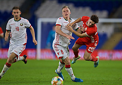 CARDIFF, WALES - Monday, September 9, 2019: Belarus' Nikolai Zolotov fouls Wales' Daniel James during the International Friendly match between Wales and Belarus at the Cardiff City Stadium. (Pic by David Rawcliffe/Propaganda)