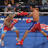 Miguel Cotto of Puerto Rico (left) and Delvin Rodriguez of the Dominican Rebublic square off during their 12-round super welterweight bout at the Amway Center in Orlando, Florida on Saturday, October 5, 2013. Cotto won by knockout in the 3rd round of the match. Cotto went on to win the match in the 3rd round. (Photo/Alex Menendez)
