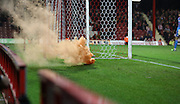 Flare during 2nd half by wolves fans during the Sky Bet Championship match between Brentford and Wolverhampton Wanderers at Griffin Park, London, England on 29 November 2014.