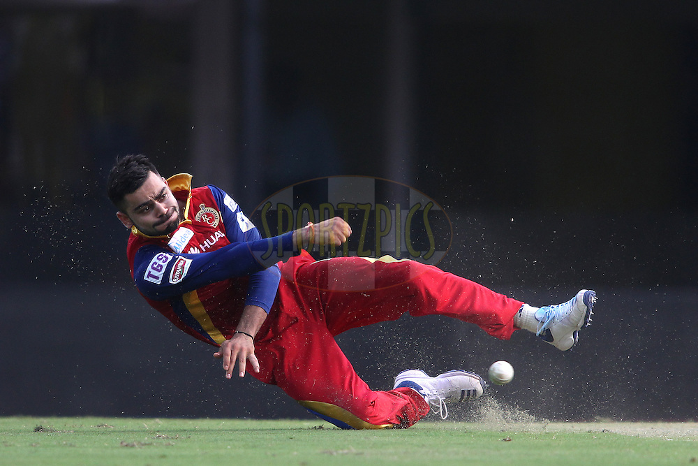 Royal Challengers Bangalore captain Virat Kohli fields the ball during match 37 of the Pepsi IPL 2015 (Indian Premier League) between The Chennai Superkings and The Royal Challengers Bangalore held at the M. A. Chidambaram Stadium, Chennai Stadium in Chennai, India on the 4th May April 2015.<br /> <br /> Photo by:  Shaun Roy / SPORTZPICS / IPL