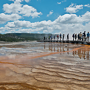 People at Grand Prismatic Spring at Midway Geyser Basin in Yellowstone National Park, Wyoming.  Photo by William Byrne Drumm.