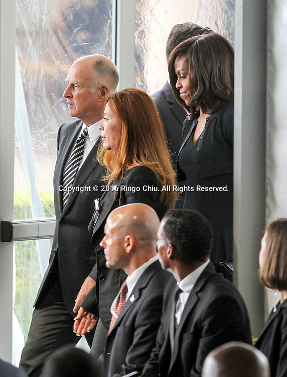 Gov. Jerry Brown, left, and First Lady Michelle Obama arrival during a funeral service for the former first lady Nancy Reagan at the Ronald Reagan Presidential Library and Museum in Simi Valley, California on March 11, 2016. Reagan died of congestive heart failure in her sleep at her Bel Air home Sunday at age 94. A bout 1,000 guests from the world of politics attended the final farewell to Nancy Reagan as the former first lady is eulogized and laid to rest next to her husband at his presidential library.<br />    (Photo by Ringo Chiu/PHOTOFORMULA.com)<br /> <br /> Usage Notes: This content is intended for editorial use only. For other uses, additional clearances may be required.