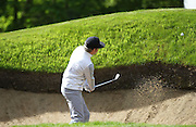 Niall Horan CHIPPING OUT OF A BUNKER at the BMW PGA Championship Celebrity Pro-Am Challenge at the Wentworth Club, Virginia Water, United Kingdom on 20 May 2015