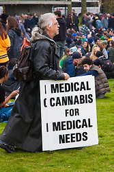 Hyde Park, London, April 19th 2015. Hundreds of cannabis users and their supporters gather at Speaker's Corner in Hyde Park for the annual London 420 pro-cannabis rally, under the watcful eye of Metropolitan Police officers, who kept a reasonably low profile, allowing the rally to continue without any serious incidents. PICTURED: Many campaigners for medical cannabis attend the rally, evangelising the medicinal properties of the outlawed herb.