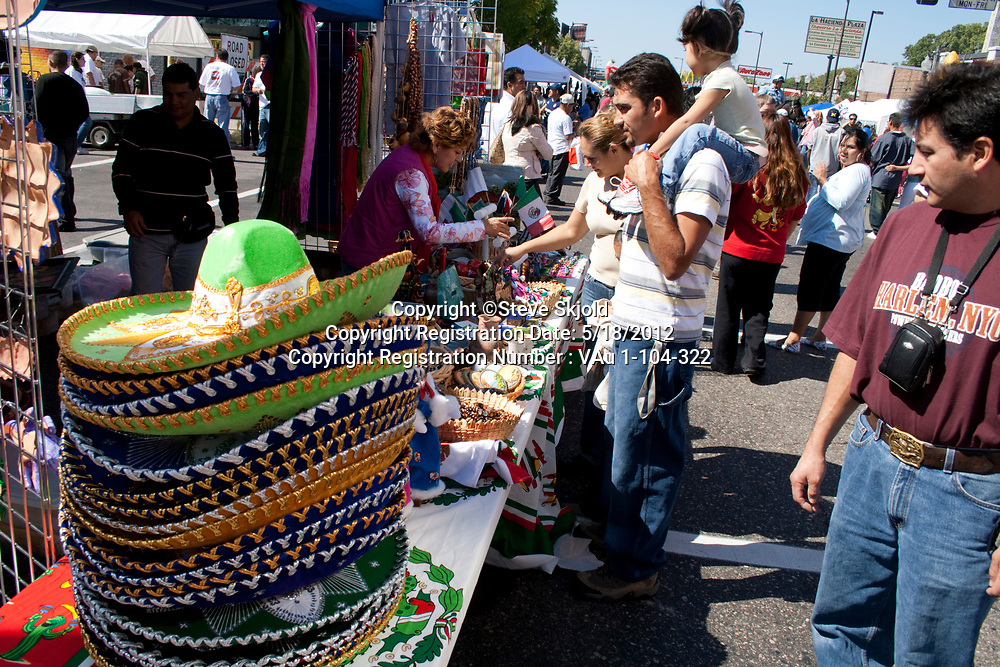 Street vendors selling Mexican sombreros and other ethnic items. Mexican Independence Day Minneapolis Minnesota MN USA