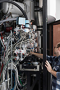 Cambridge, England, Uk, March 21 2019 - A cryo-electron microscope (CryoEM) developped by Pr Richard Henderson, led him to the 2017 Nobel Prize in Chemistry, at MRC Laboratory of Molecular Biology..<br /> The Medical Research Council (MRC) Laboratory of Molecular Biology (LMB) is a research institute in Cambridge, England, involved in the revolution in molecular biology which occurred in the 1950–60s. Since then it has remained a major medical research laboratory with a much broader focus. A new £212m replacement building constructed close by to the original site on the Cambridge Biomedical Campus was opened in May 2013. The road outside the new building is named Francis Crick Avenue after the 1962 joint Nobel Prize winner, who co-discovered the helical structure of DNA in 1953. <br /> The work of LMB scientists has been awarded 12 Nobel prizes: 9 in the field of chemistry and 3 for physiology or medicine. These prizes celebrate key advances in primary scientific research and for developing pioneering techniques for molecular biology. The award of 2 Nobel prizes in the same year, 1962, established the Laboratory's reputation as a leading international research centre.