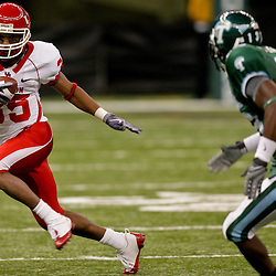 Oct 17, 2009; New Orleans, LA, USA;  Houston Cougars wide receiver Tyron Carrier (35) runs as Tulane Green Wave cornerback Phillip Davis (13) pursues during a game at the Louisiana Superdome. Houston defeated Tulane 44-16.   Mandatory Credit: Derick E. Hingle-US PRESSWIRE