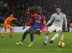 Crystal Palace's Wilfried Zaha (left) and Cardiff City captain Sean Morrison battle for the ball, during the Premier League match at Selhurst Park, south east London.