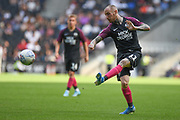 Peterborough United midfielder Marcus Maddison (11) takes a shot at goal during the EFL Sky Bet League 1 match between Milton Keynes Dons and Peterborough United at stadium:mk, Milton Keynes, England on 24 August 2019.